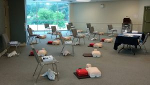 First aid training classroom with physical distancing layout. Workstations are two metres apart.